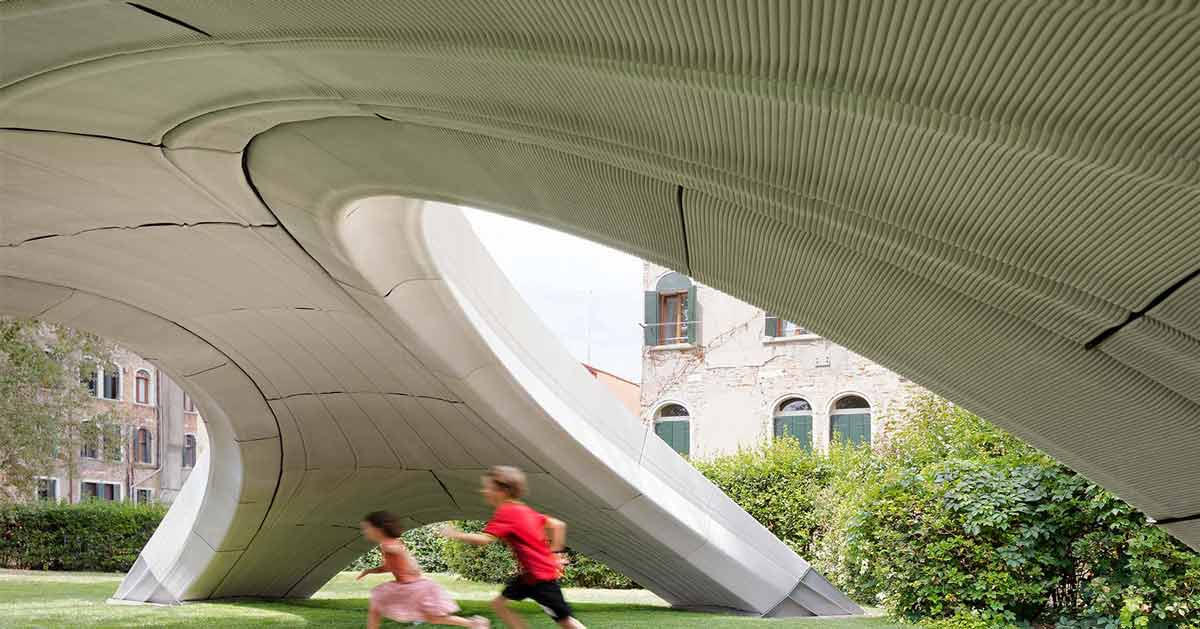 The bottom of a bridge is shown — with the concrete grooved in long patterns. Children run underneath on the grass.