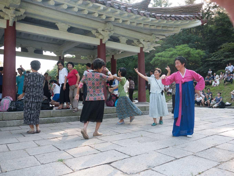 Women dancing at event in North Korea
