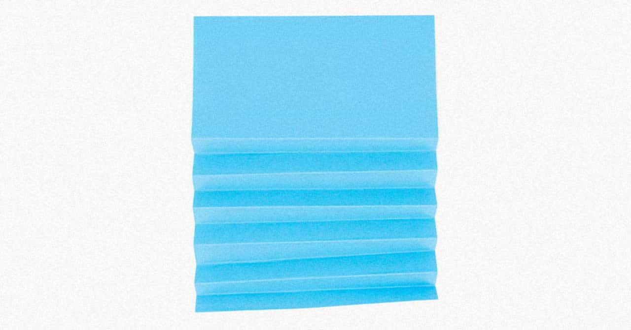Folded blue paper on a white background