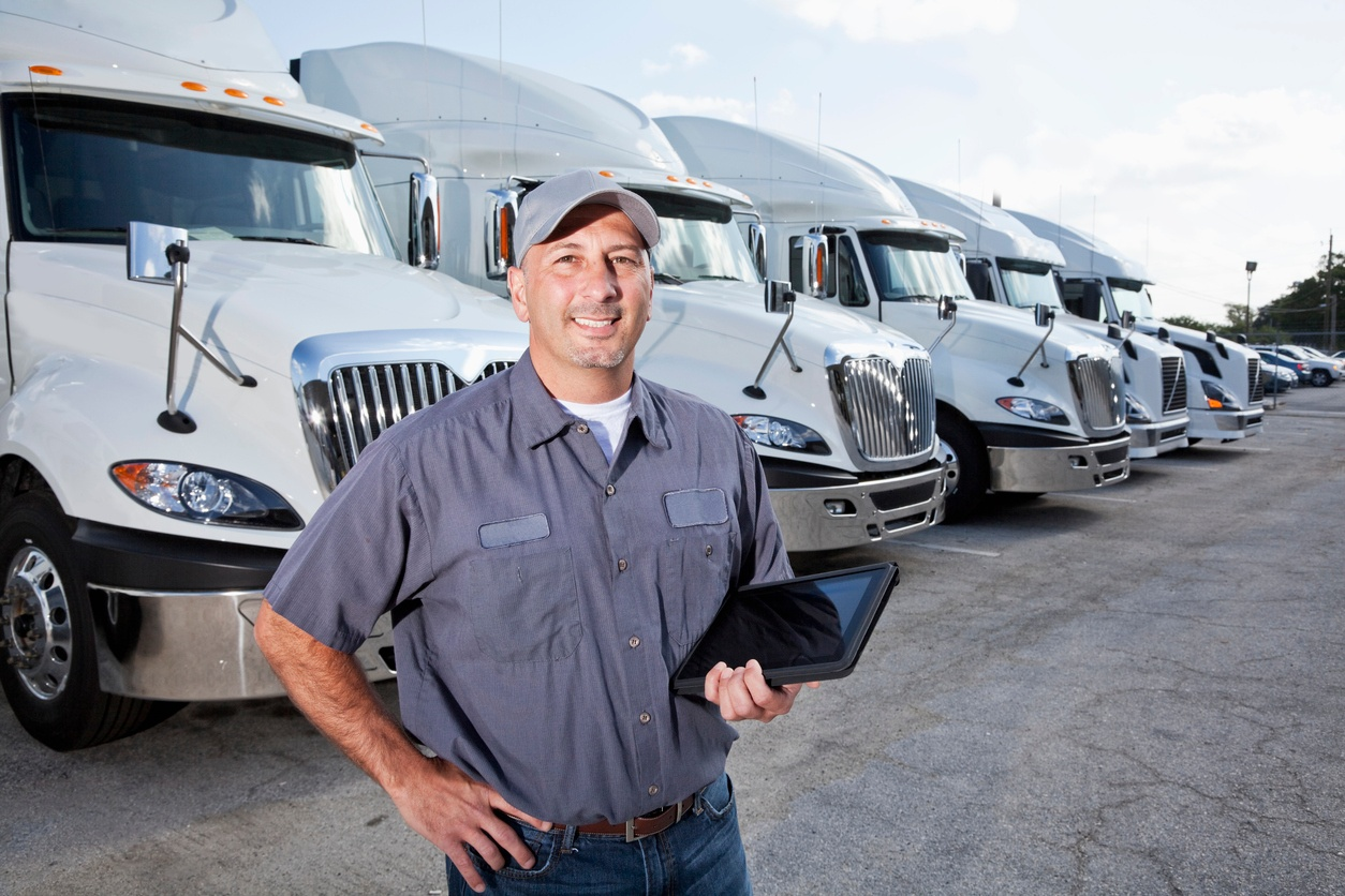 Truck Driver Holding Tablet