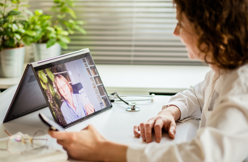 Woman practicing Telehealth on a laptop