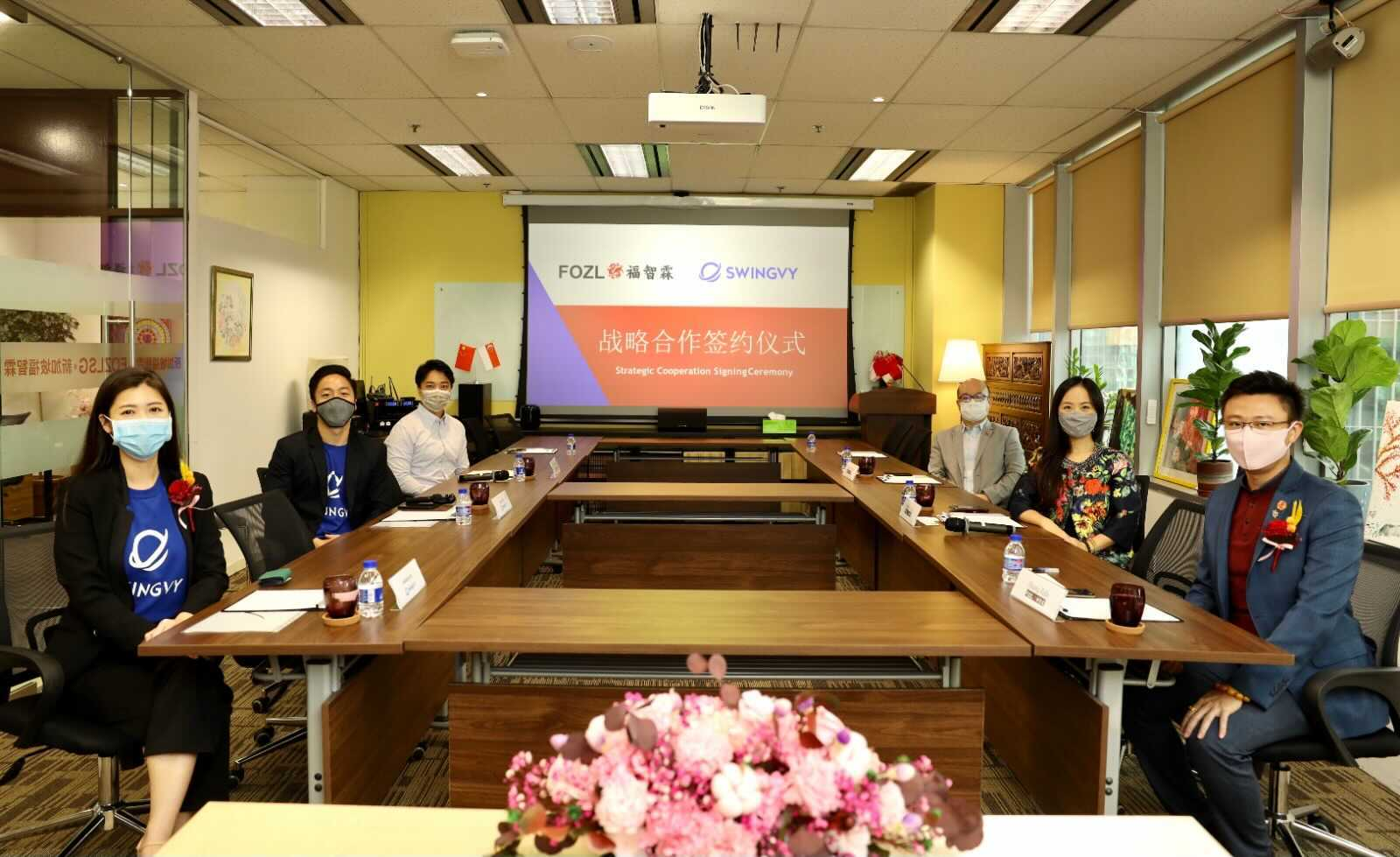 Swingvy and FOZL Group partner signing ceremony.