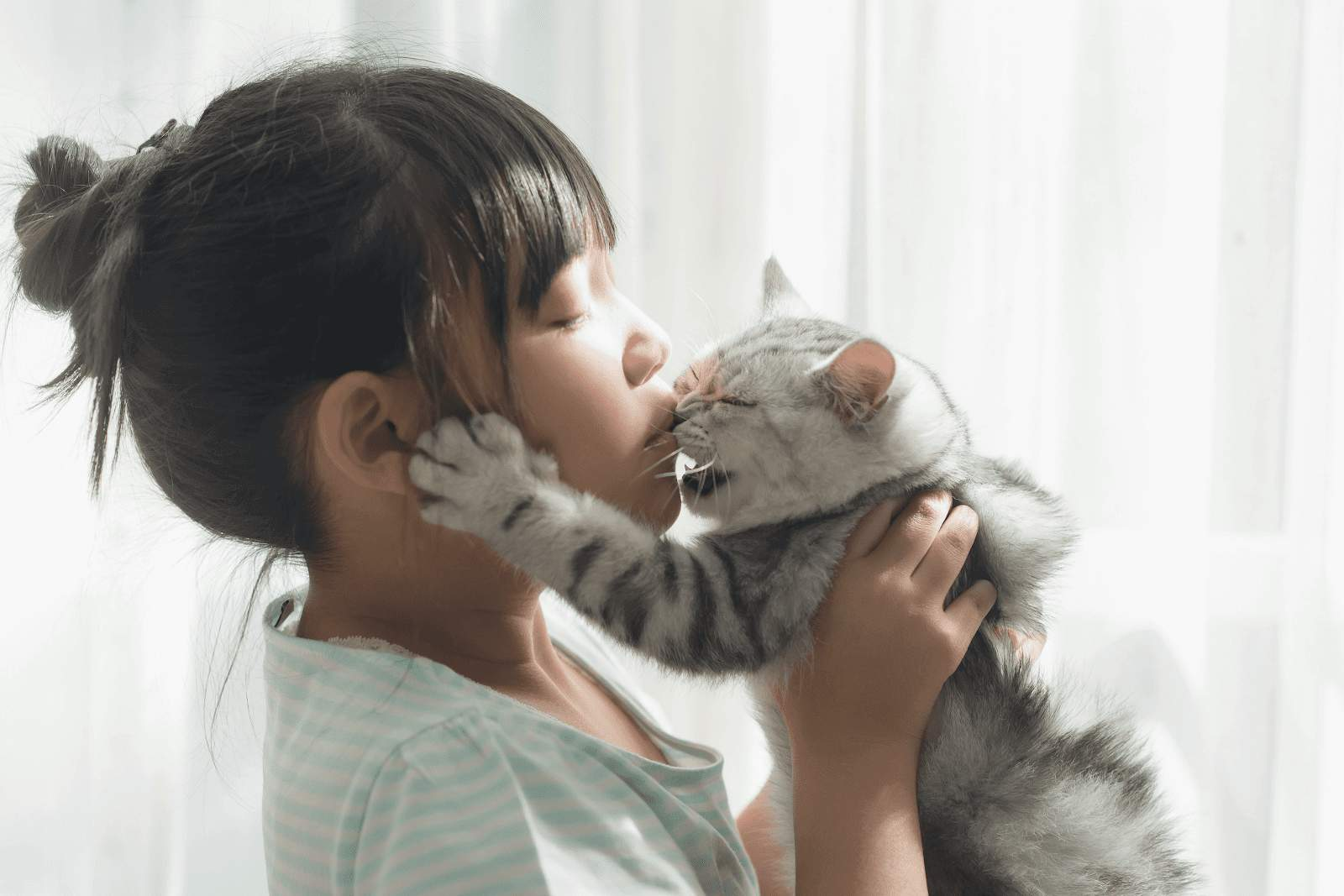 girl having a good time with her cat