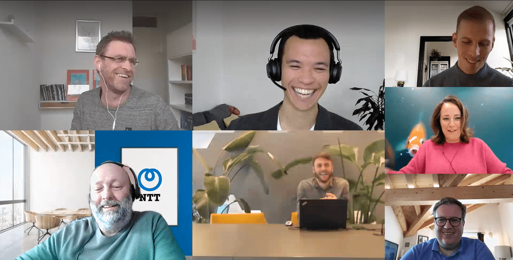 Participants of Mapiq Expert talks, smiling during the virtual session. Enhancing the office for hybrid work.