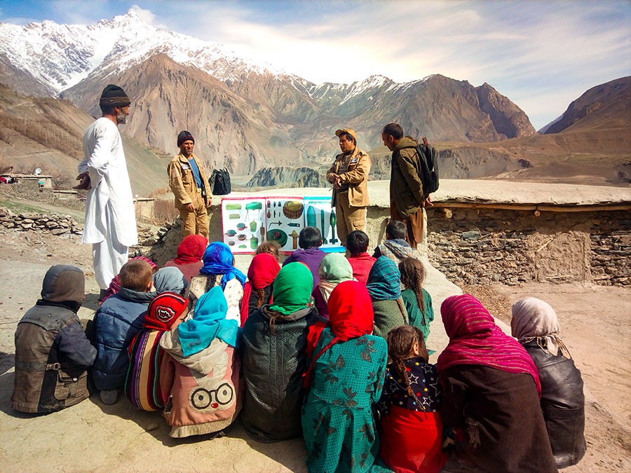 FSD employees and children in an EORE session in front of the mountains