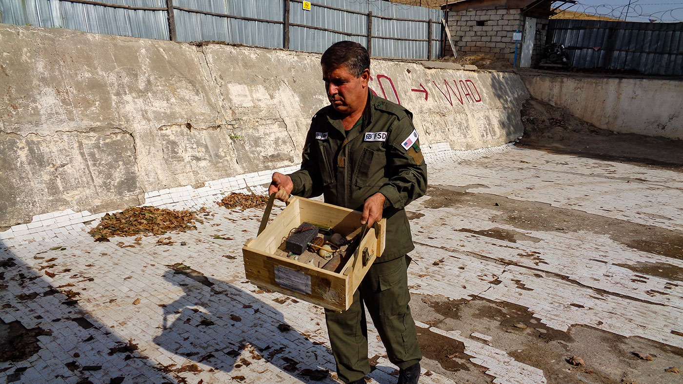 A deminer with explosives which they found