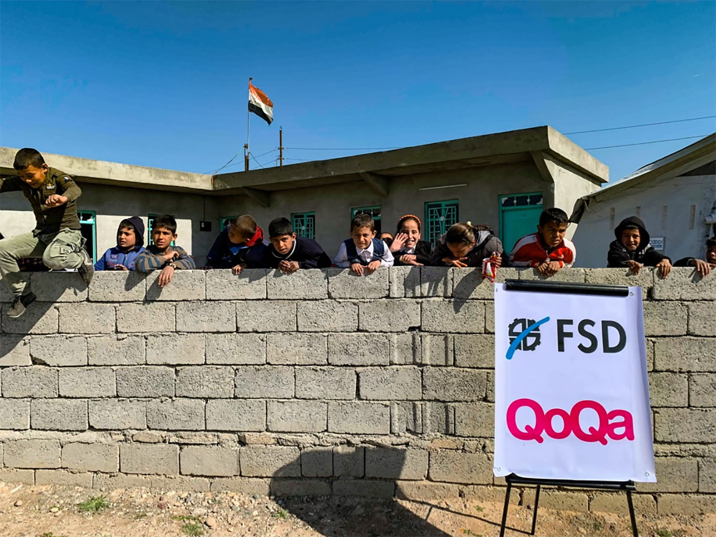 whiteboard with fsd and qoqa logo