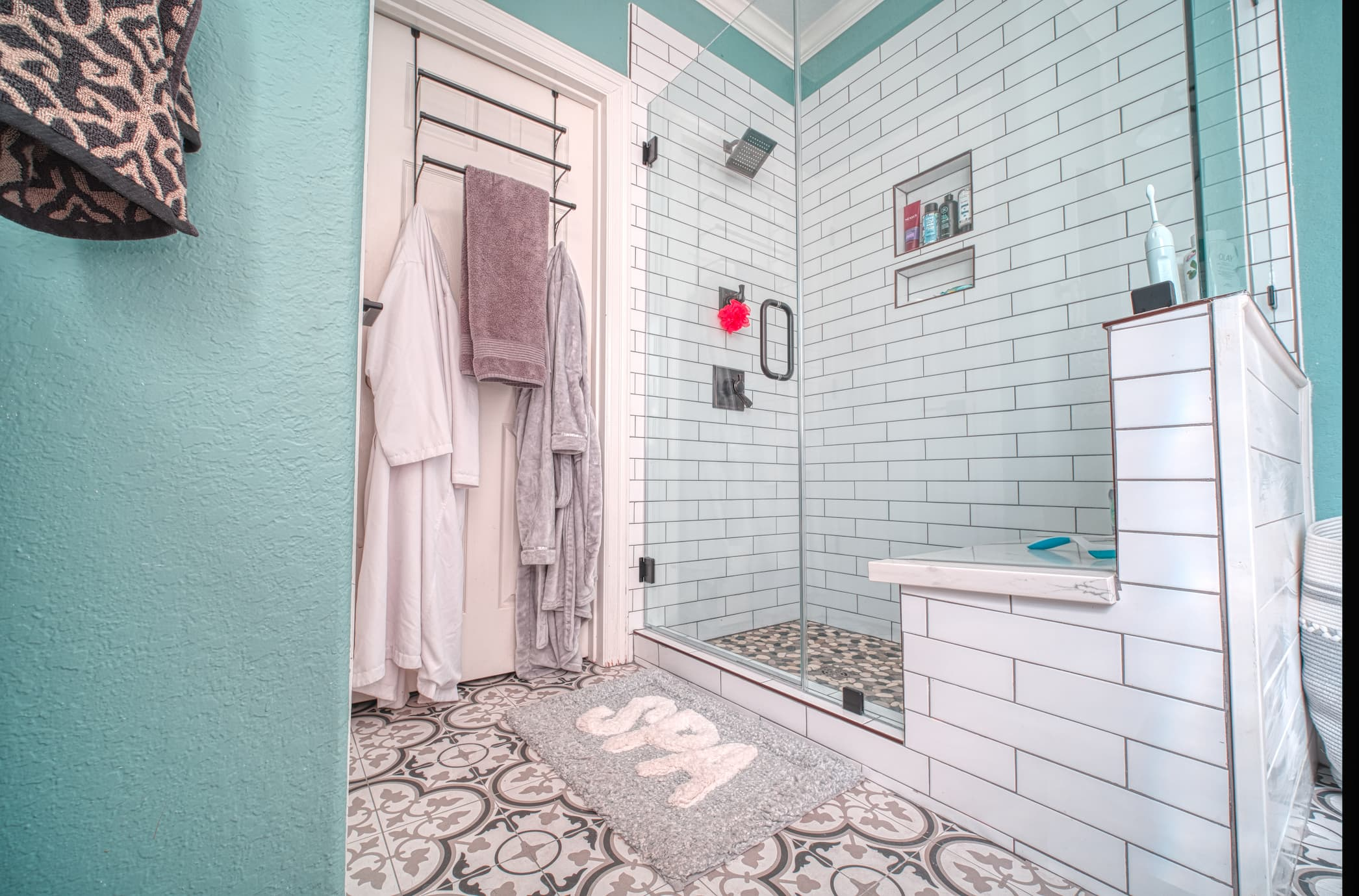 White Subway Tile Shower with Pebble Rock Shower Pan