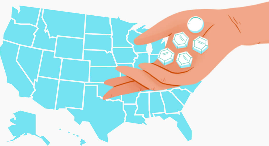 United States with a hand holding pills