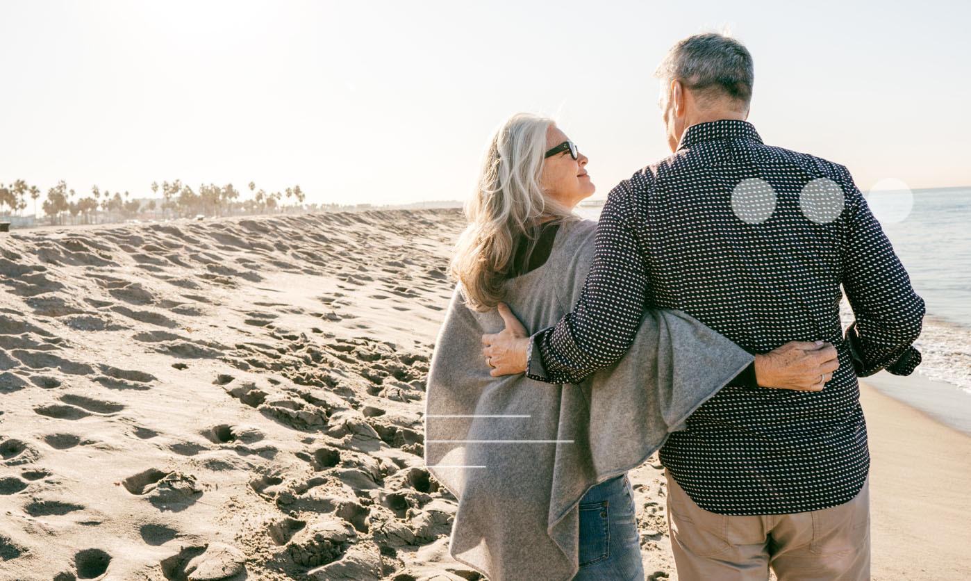 A couple walking down the beach