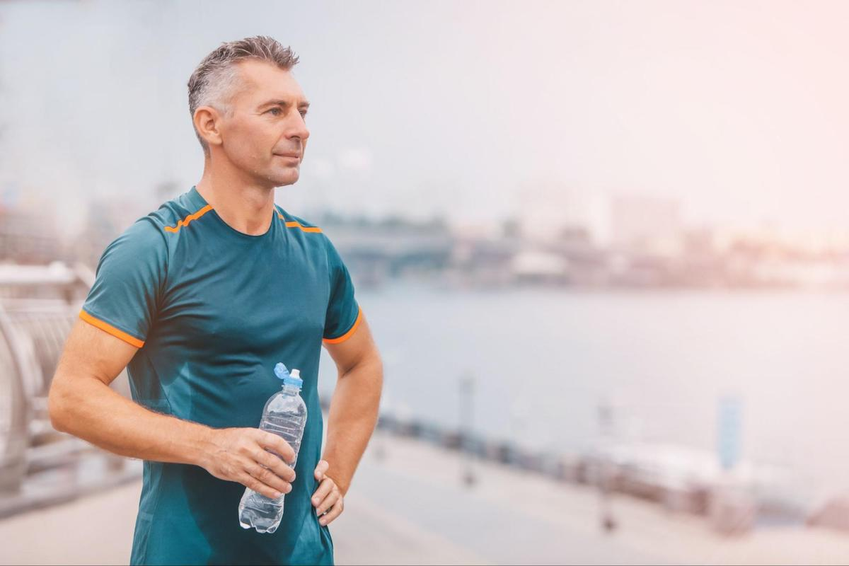 metabolic health: man holding a water bottle