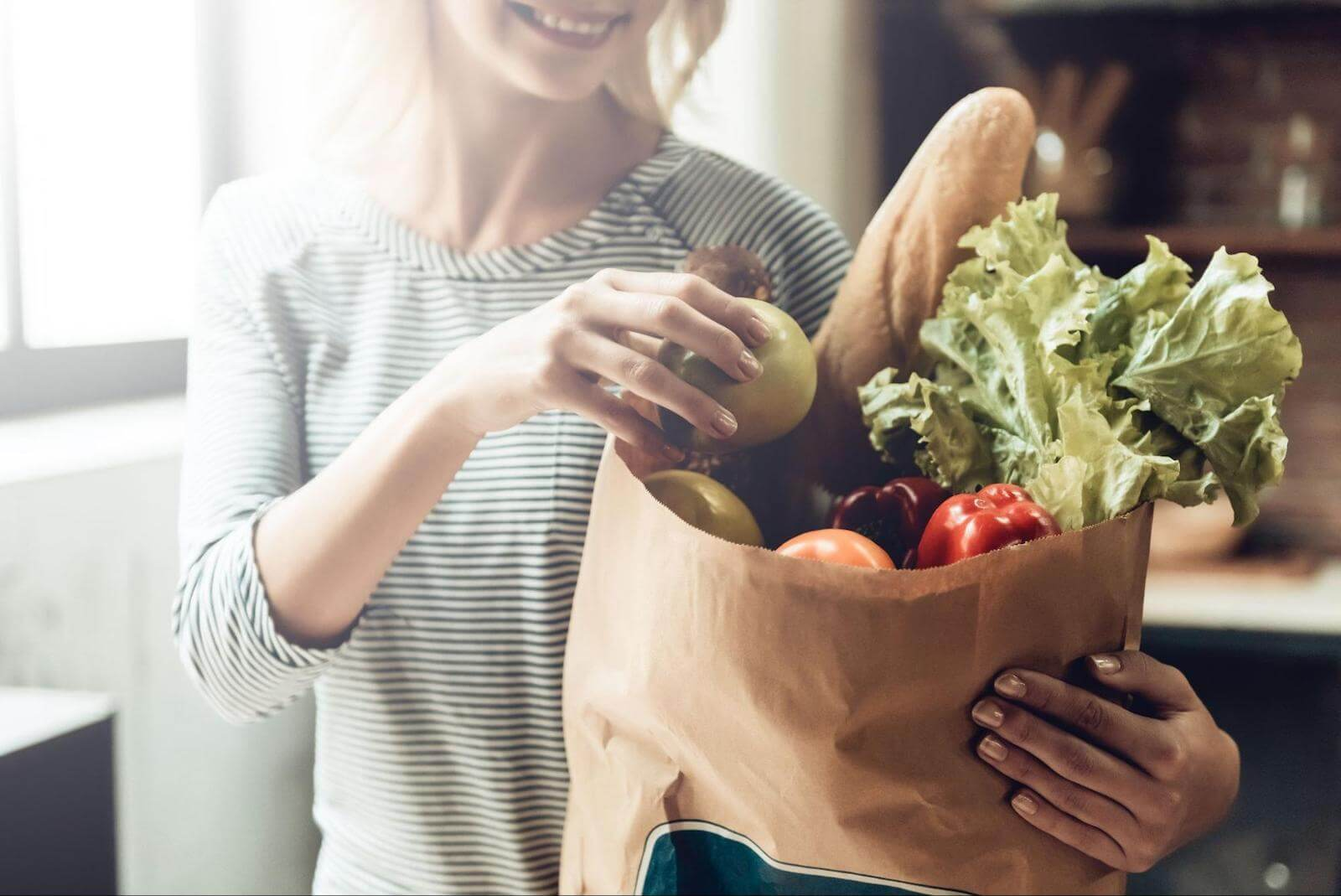 Circadian rhythm fasting: woman carrying groceries