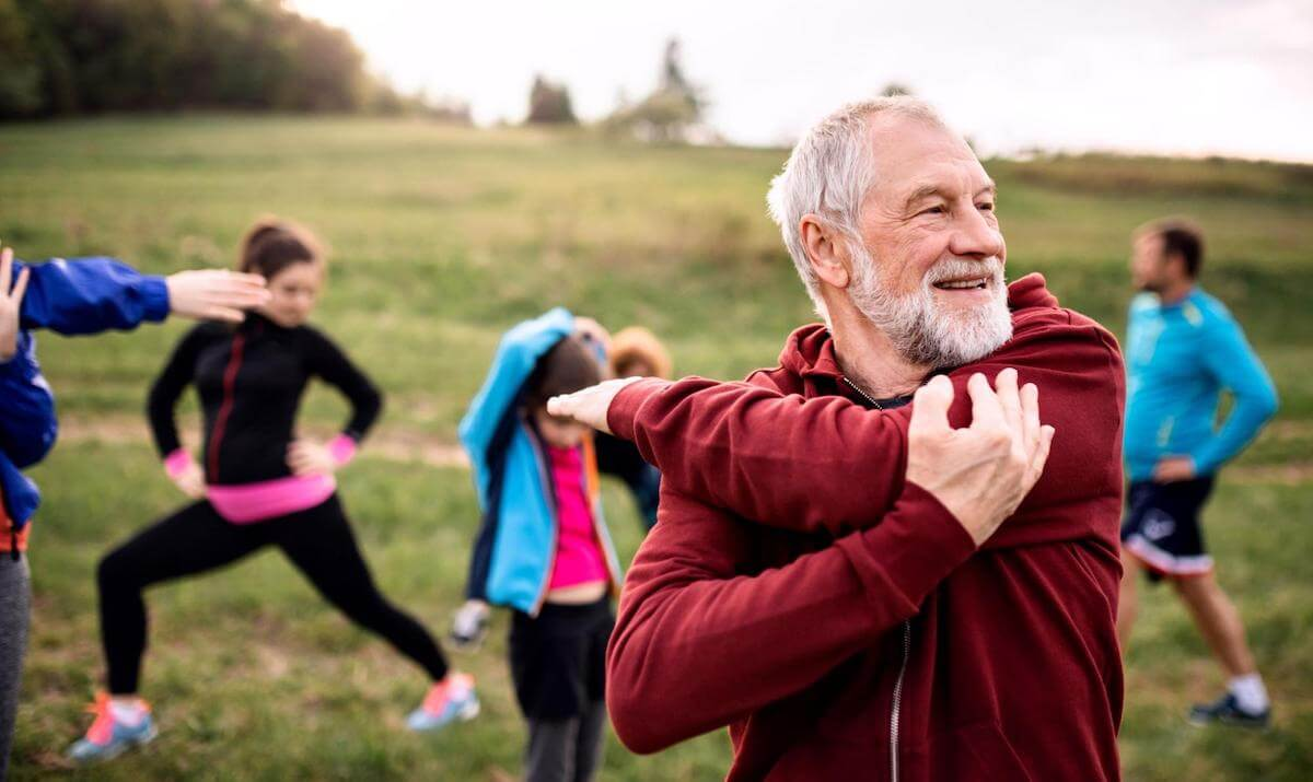 Fasting blood sugar levels: A man stretches outdoors with a group