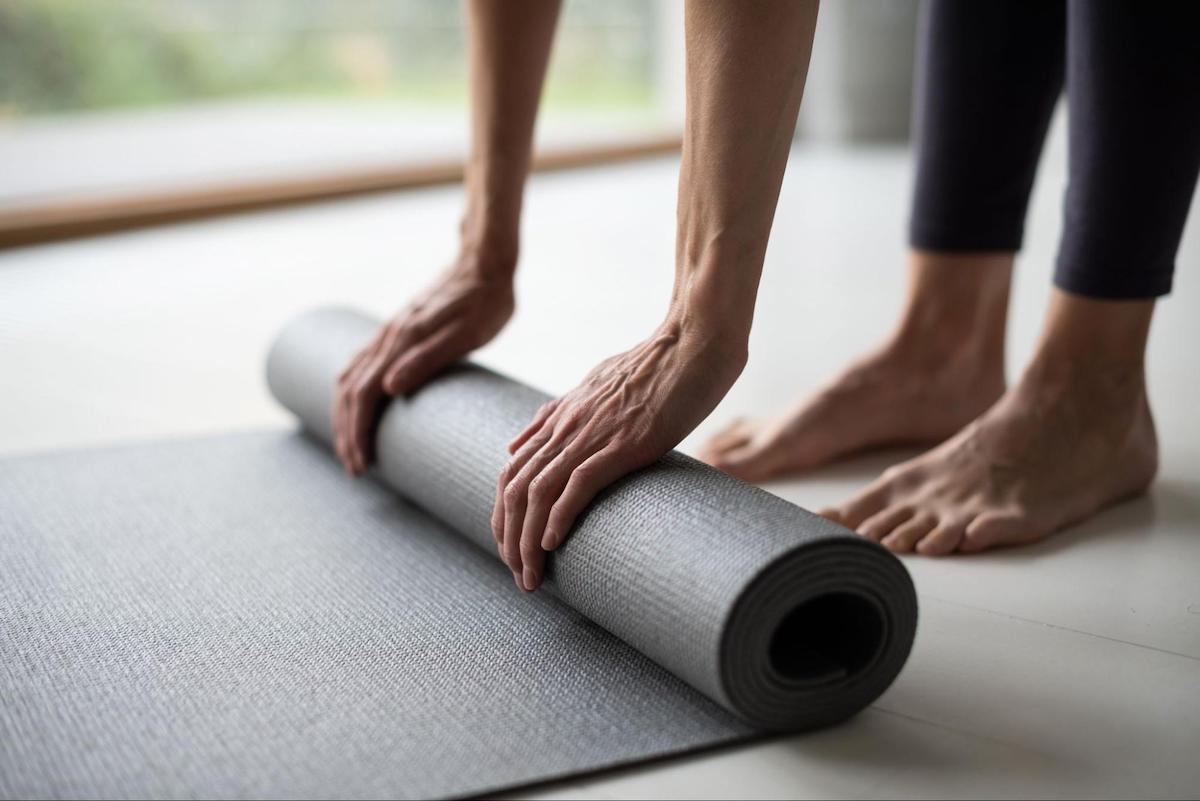 Normal blood sugar levels: A closeup of two hands unrolling a yoga mat