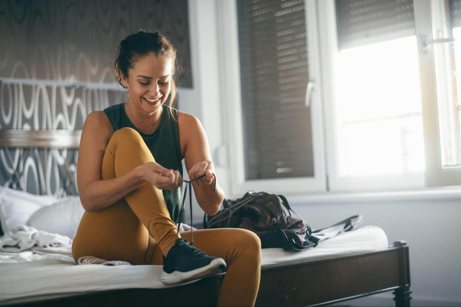 How to reset your metabolism: A woman ties her shoes before a workout
