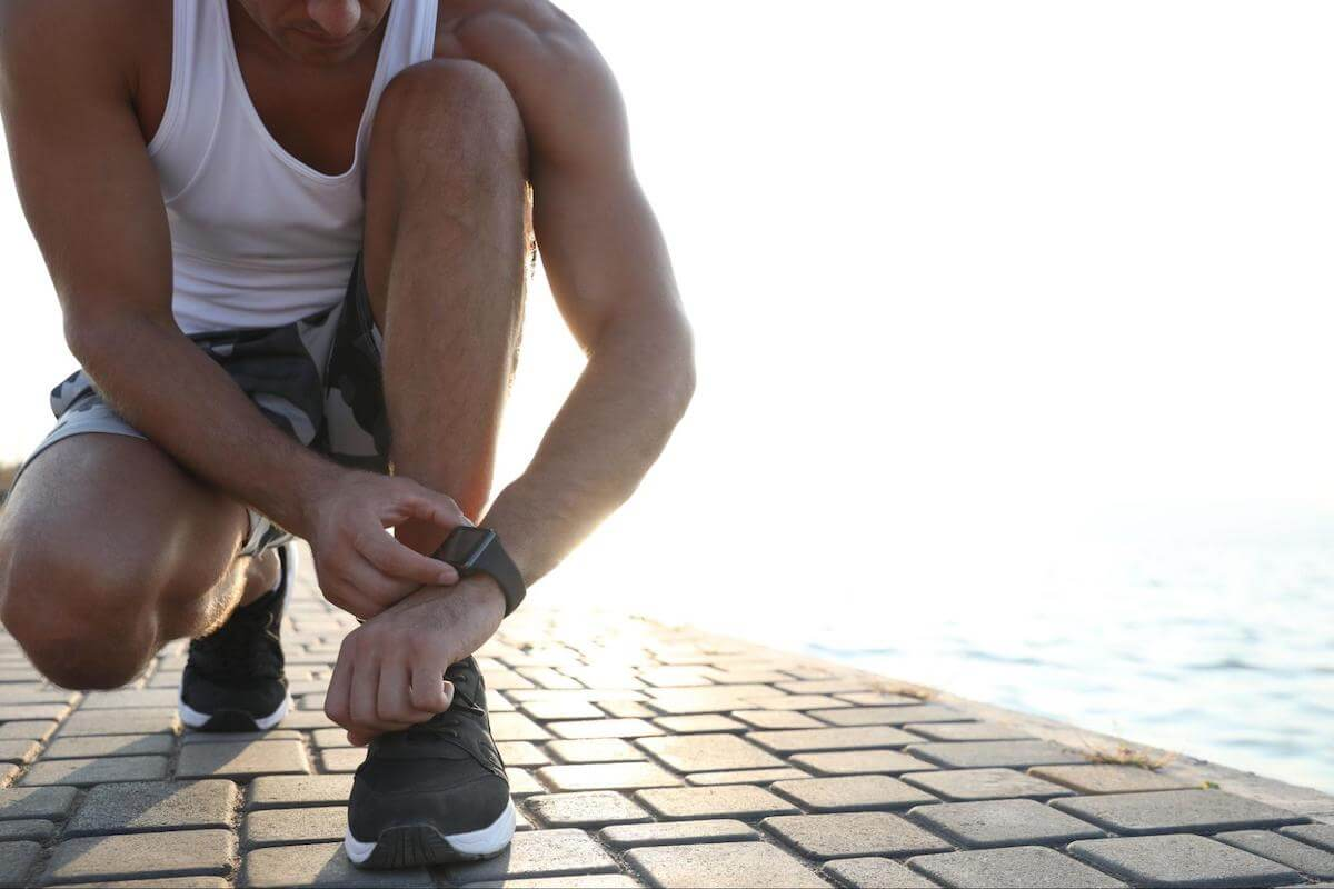 Athletic performance: man checking his watch