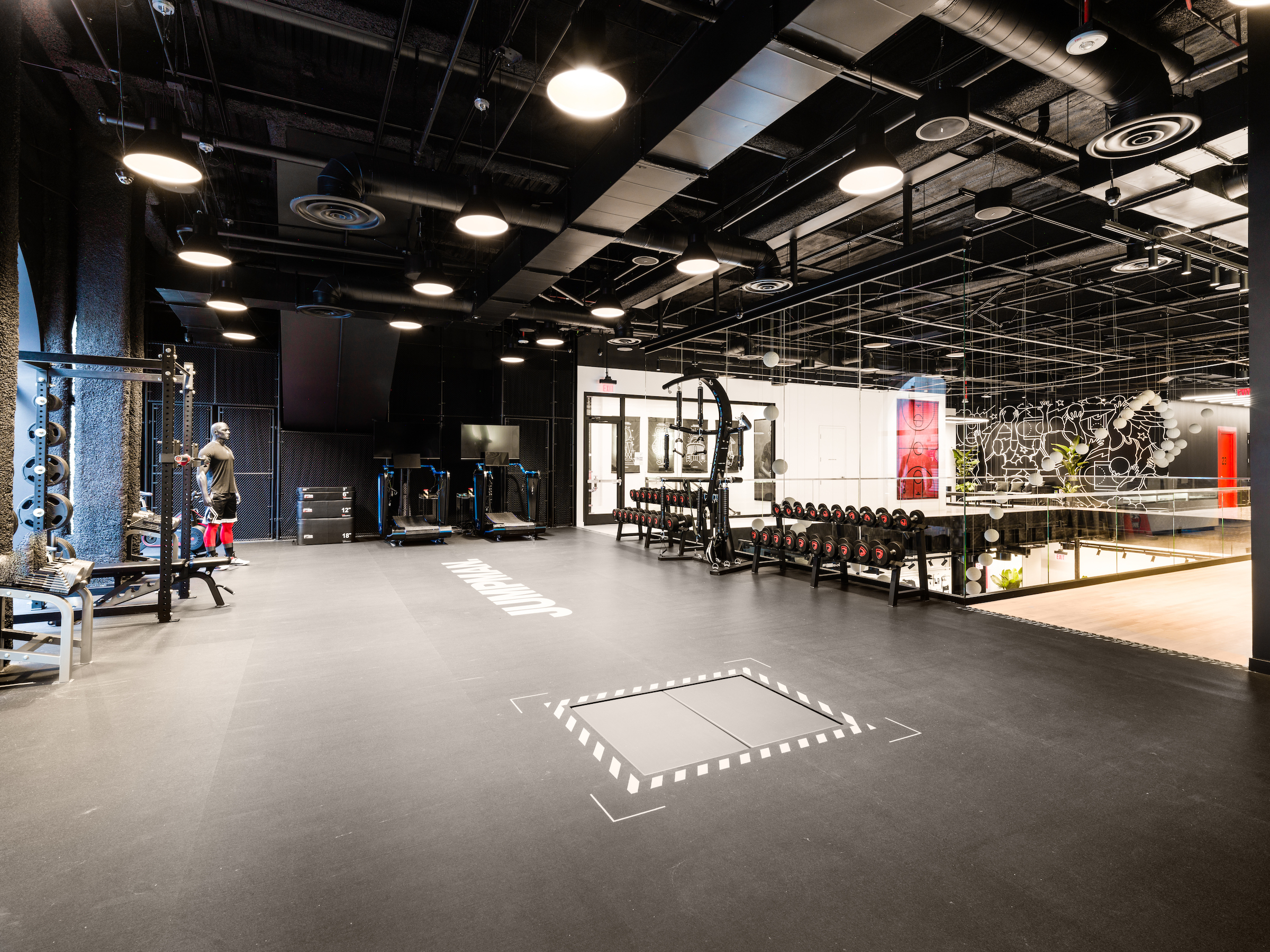 Jumpman LA - Gym area with open ceiling and lighting