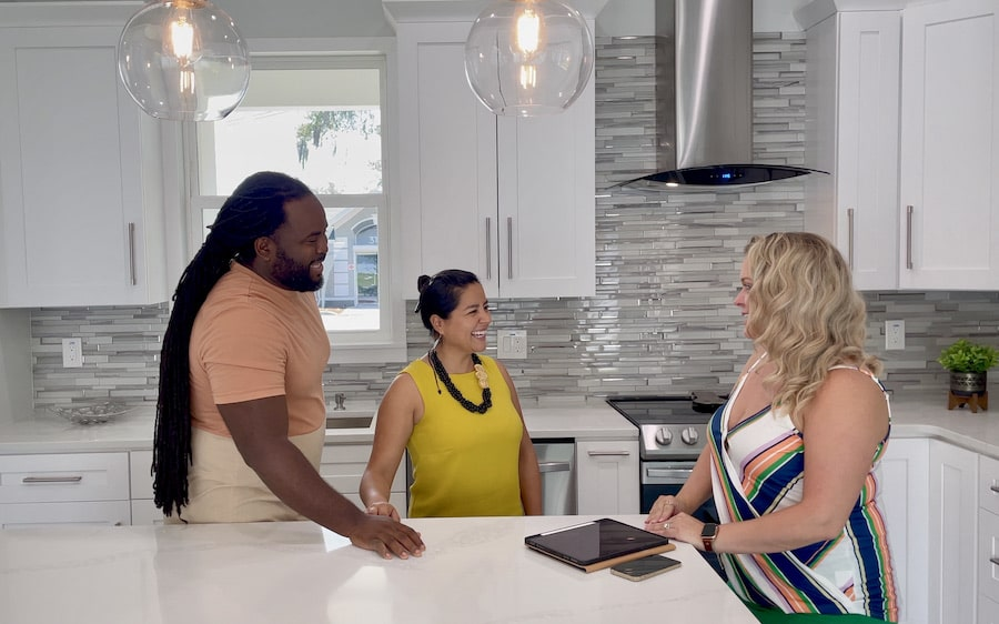 Jacee Monsalve, Broker, working with home sellers in a kitchen.