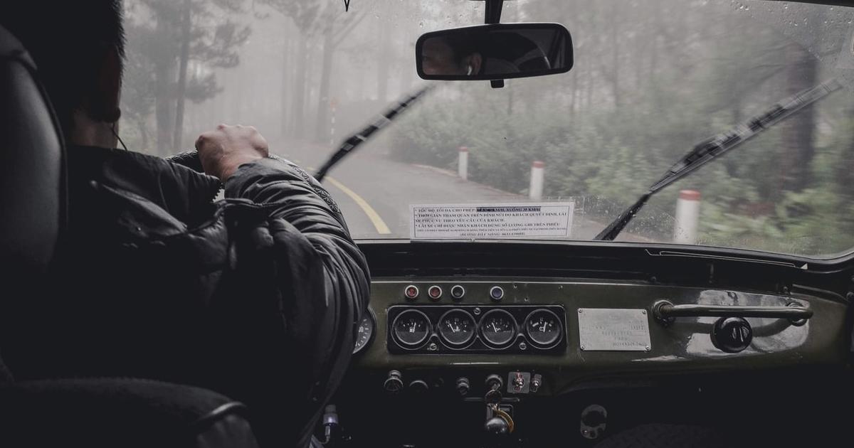 person driving in rain