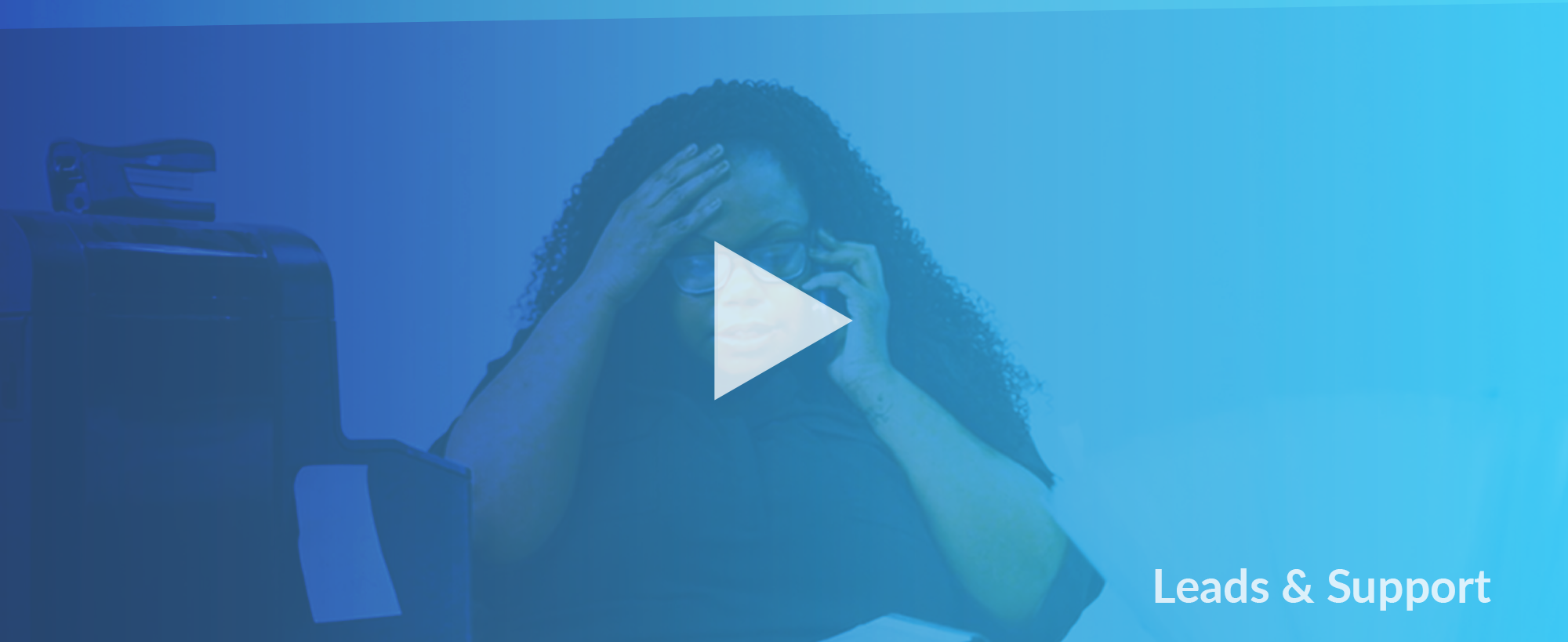 Image of businesswoman with hand on head with a play button overlay, indicating a video.