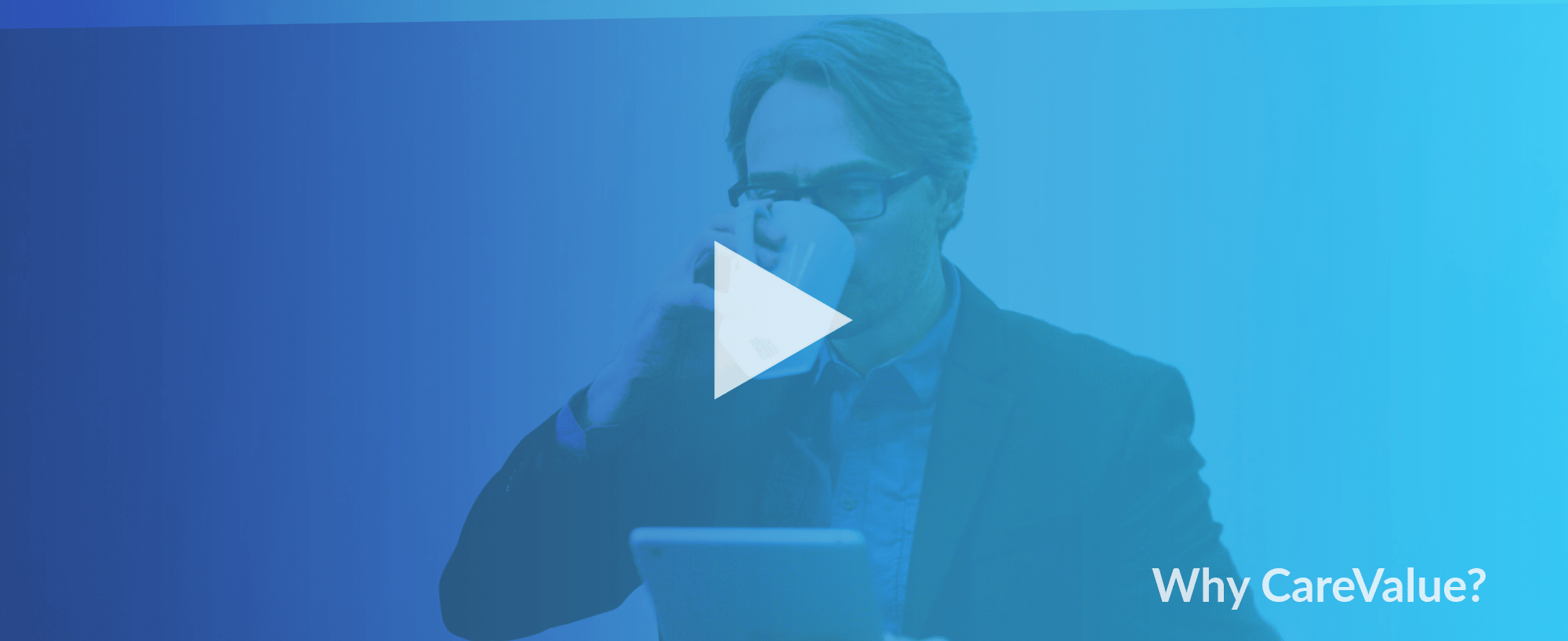 Picture of a businessman drinking coffee with a play button overlay, indicating a video.
