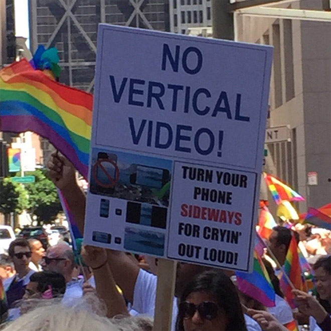 sign that reads no vertical video at a gay pride parade