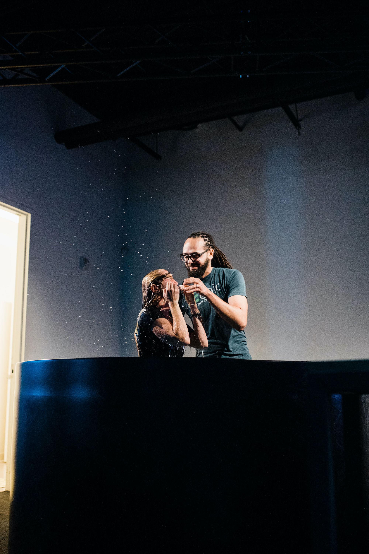 Pastor baptizing a member.