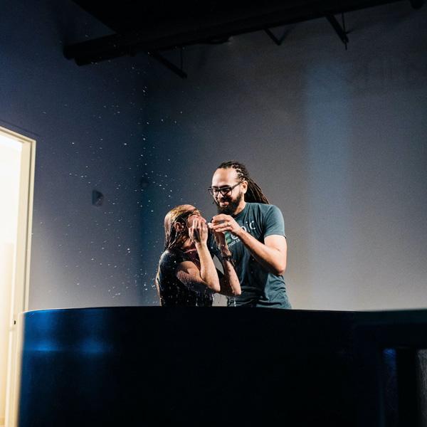 Pastor baptizing a member