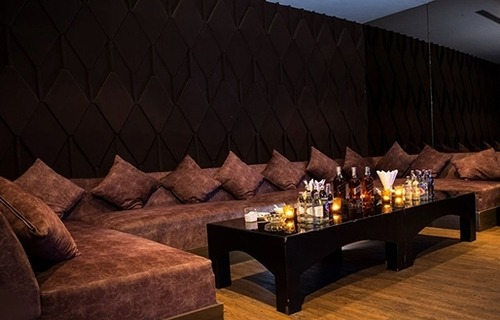 sofa and table of a medium KTV room at The PIMP gentlemen club in Bangkok