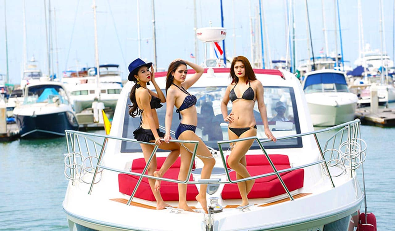 Thai Models on Yacht in the Marina
