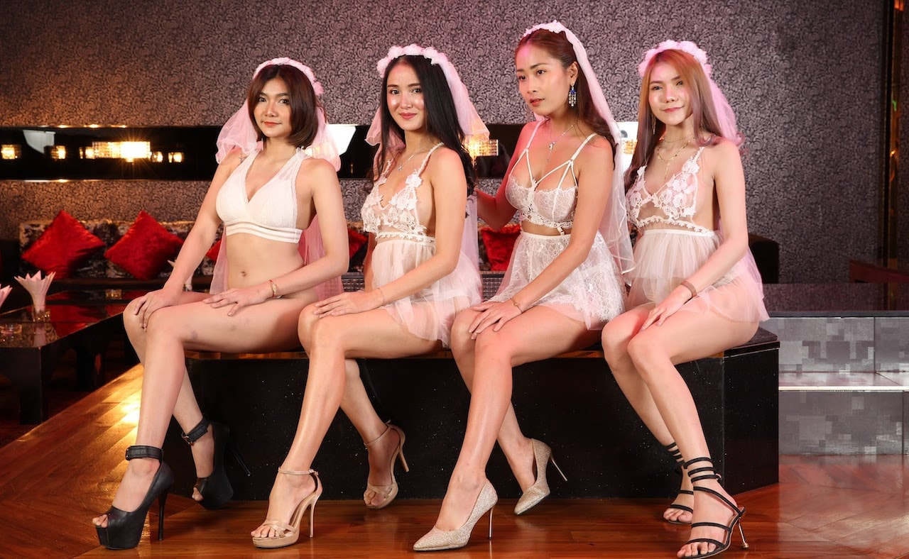 Thai girls dressed as sexy brides in a VIP room at The PIMP Bangkok