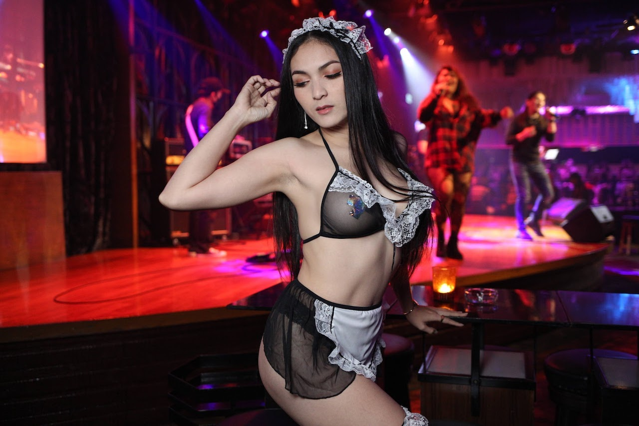 hot Thai stripper with transparent black lingerie in front of a live band at The PIMP club in Bangkok