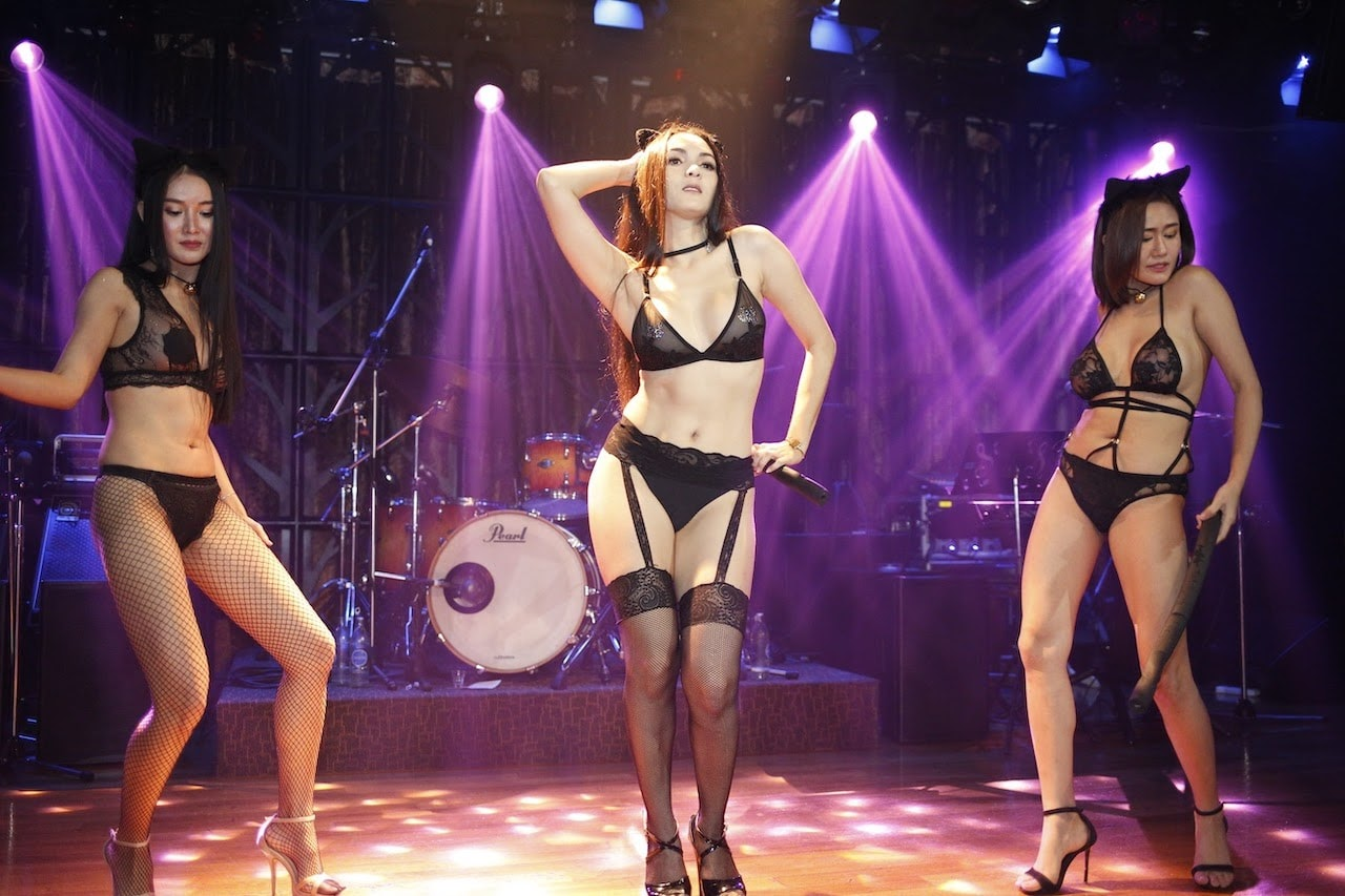 hot Thai strippers performing on stage of The PIMP Bangkok gentlemen club