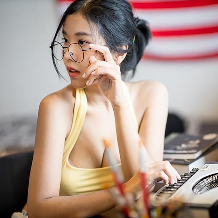 Thai girl Panidsara with her glasses and yellow top