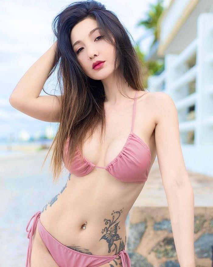hot young Thai model Kimmy wearing a bikini on the beach