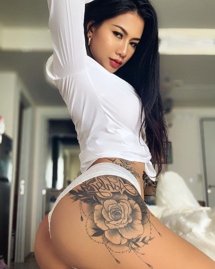 Thai model Olive Ashly with a white top and g string showing her beautiful black tattoo and her tights