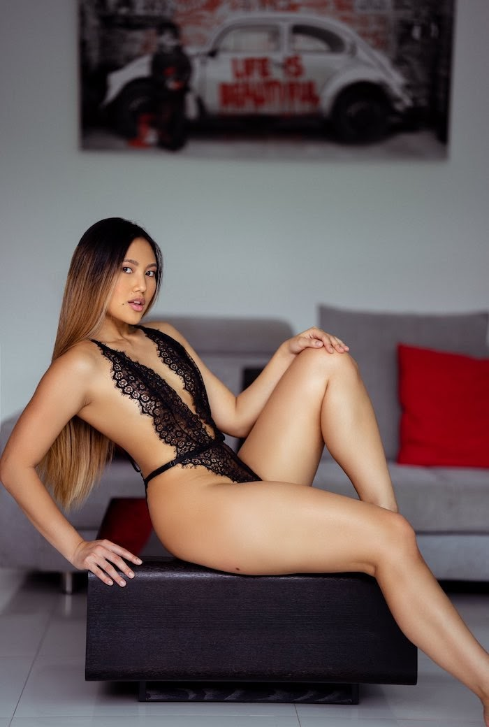 Thai porn actress May Thai in black lingerie in a photoshoot for her OnlyFans account