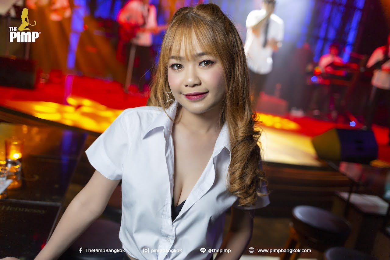 young Thai student at a KTV nightclub in Bangkok during a party