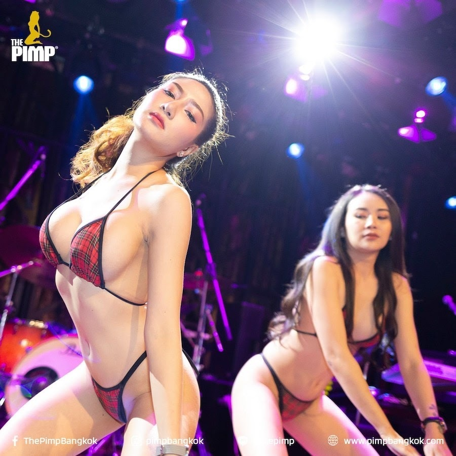 young Thai models from The PIMP Bangkok gentlemen club in red and black bikinis
