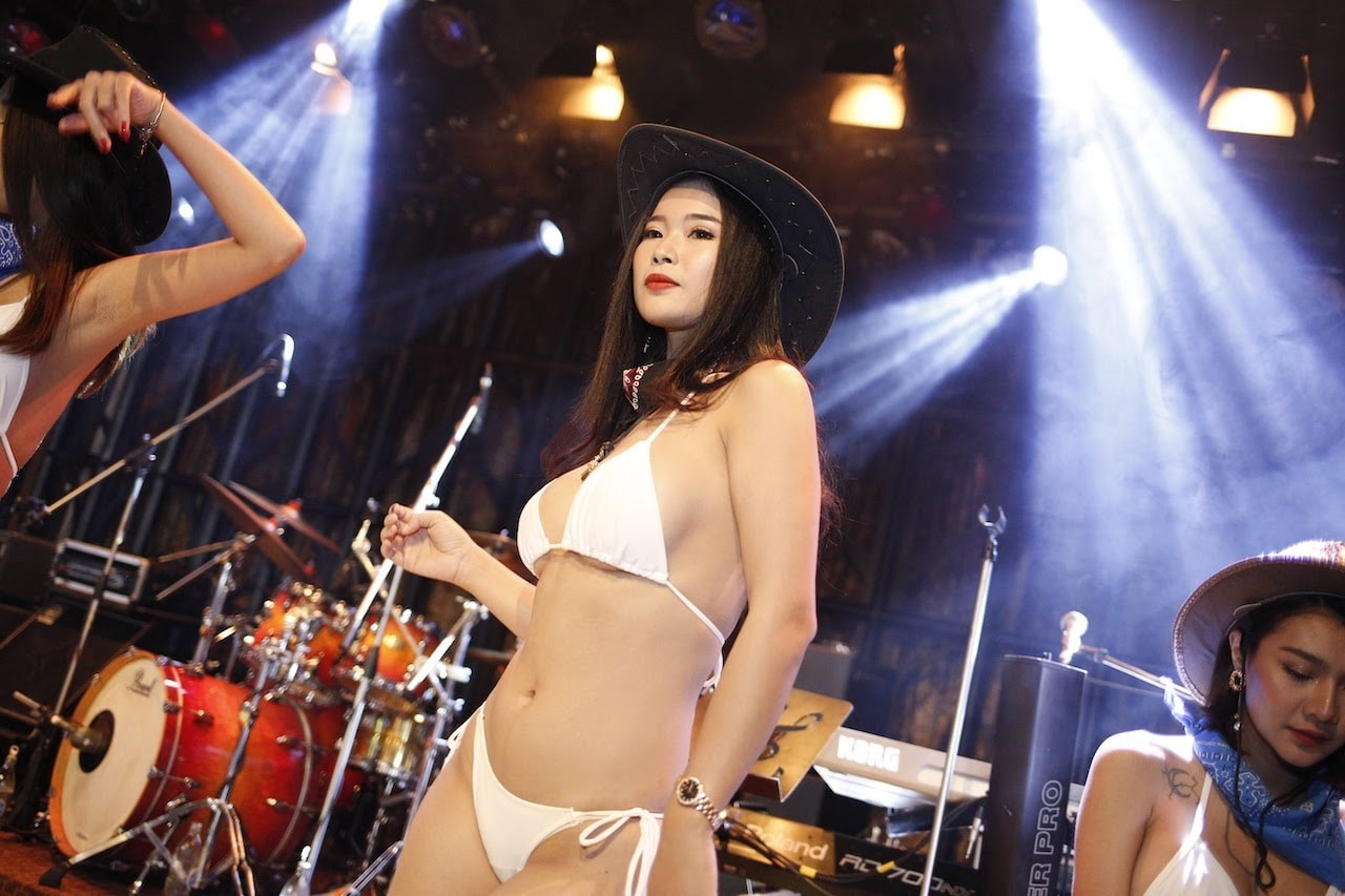 hot Thai bikini model with a cowboy hat on stage of the best club in Bangkok