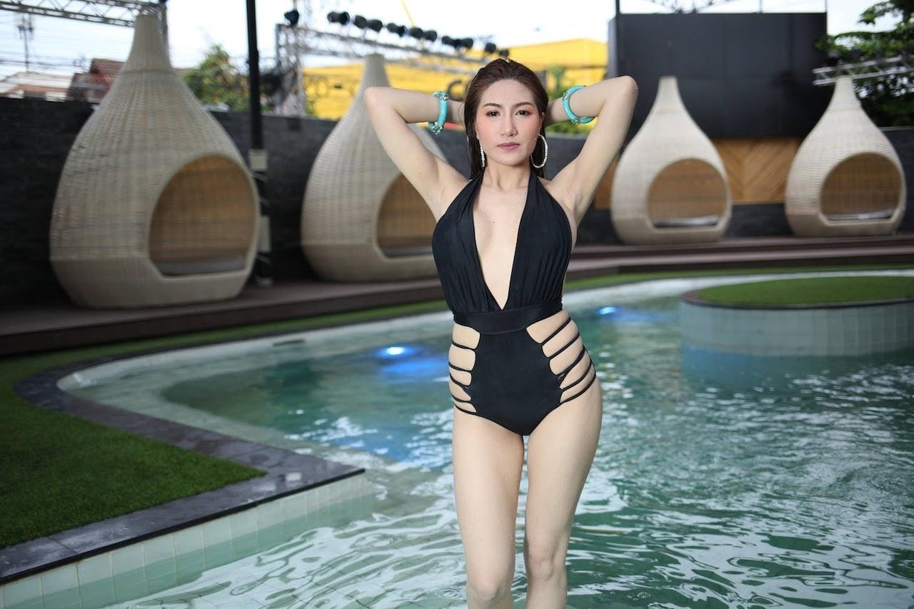 gorgeous Thai bikini model in a black swimsuit at Bangkok best gentlemen club's private pool