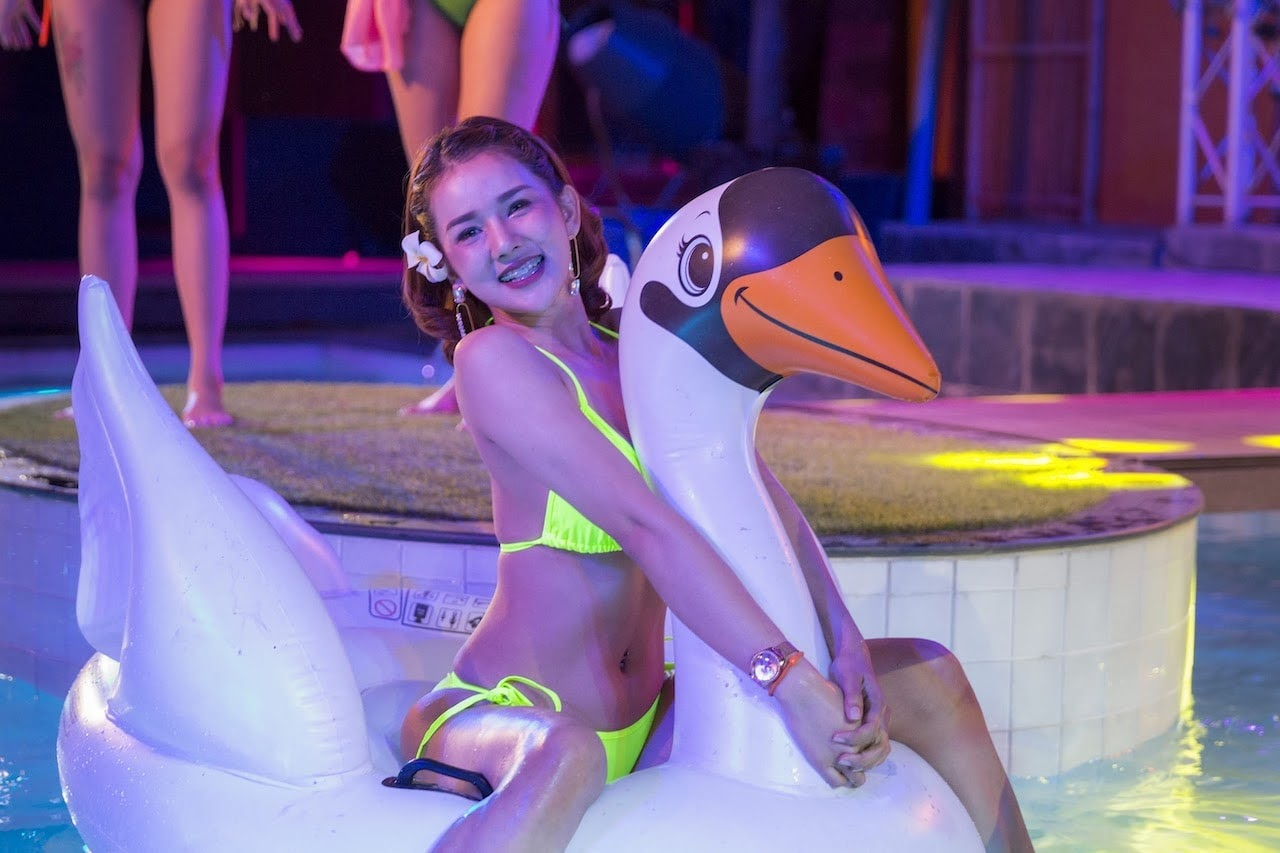 Thai bikini model on a floatable at The PIMP private pool for an exclusive party