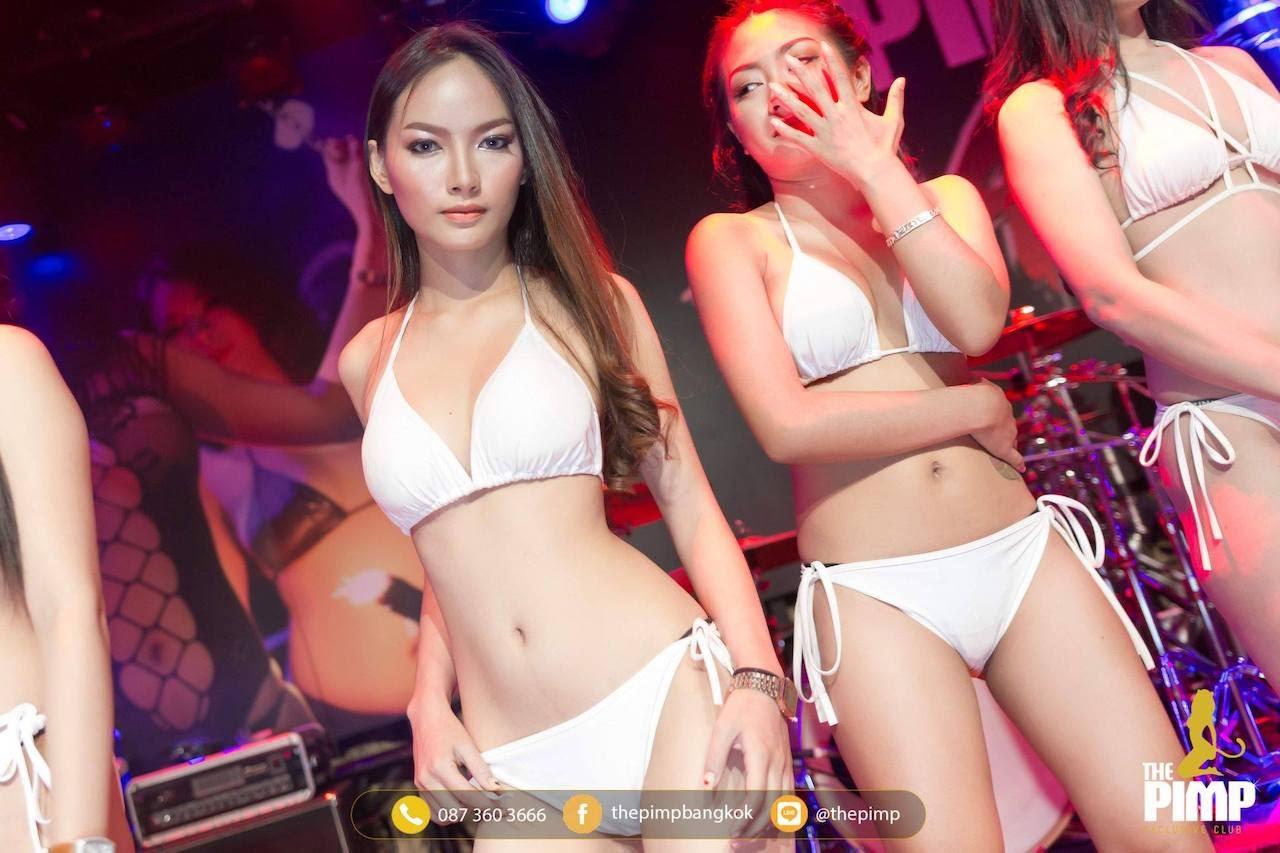 intense looking skinny Thai bikini model at The PIMP Bangkok in Thailand