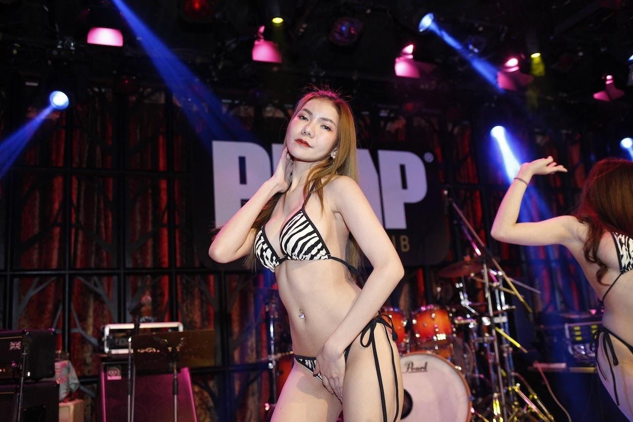 smoking hot Thai model in a zebra bikini doing a sexy pose on stage at The PIMP gentlemen club in Bangkok