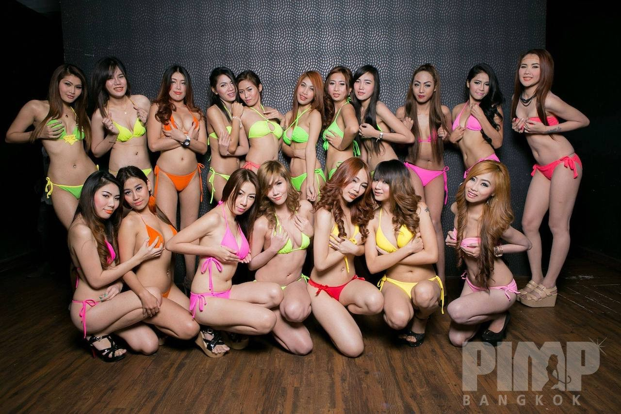 group of hot Thai bikini models in colorful swimsuits at a wild party at The PIMP Bangkok