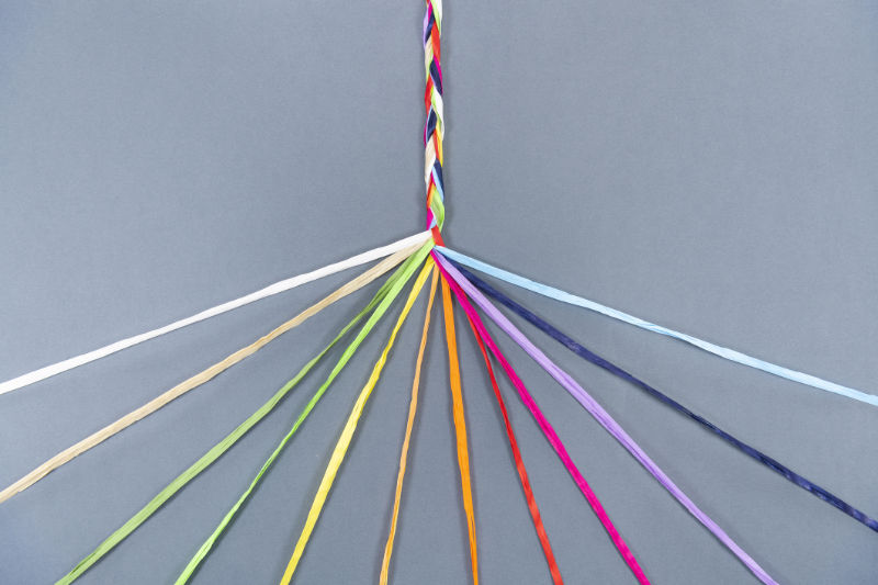 Image of different coloured strings representing Diversity