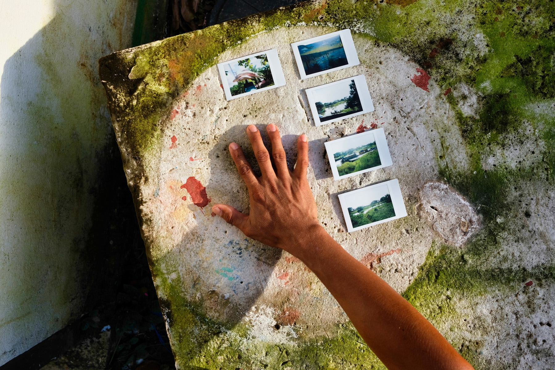 RE-MAPPING the AMAZON : Hand with Triple Border Polaroids taken by youth, Leticia, Amazonia. Collaborative photography using creative ethnography inquiry approach during workshop