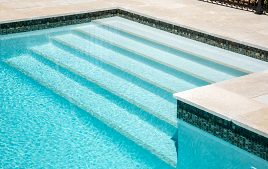 light blue pool with steps