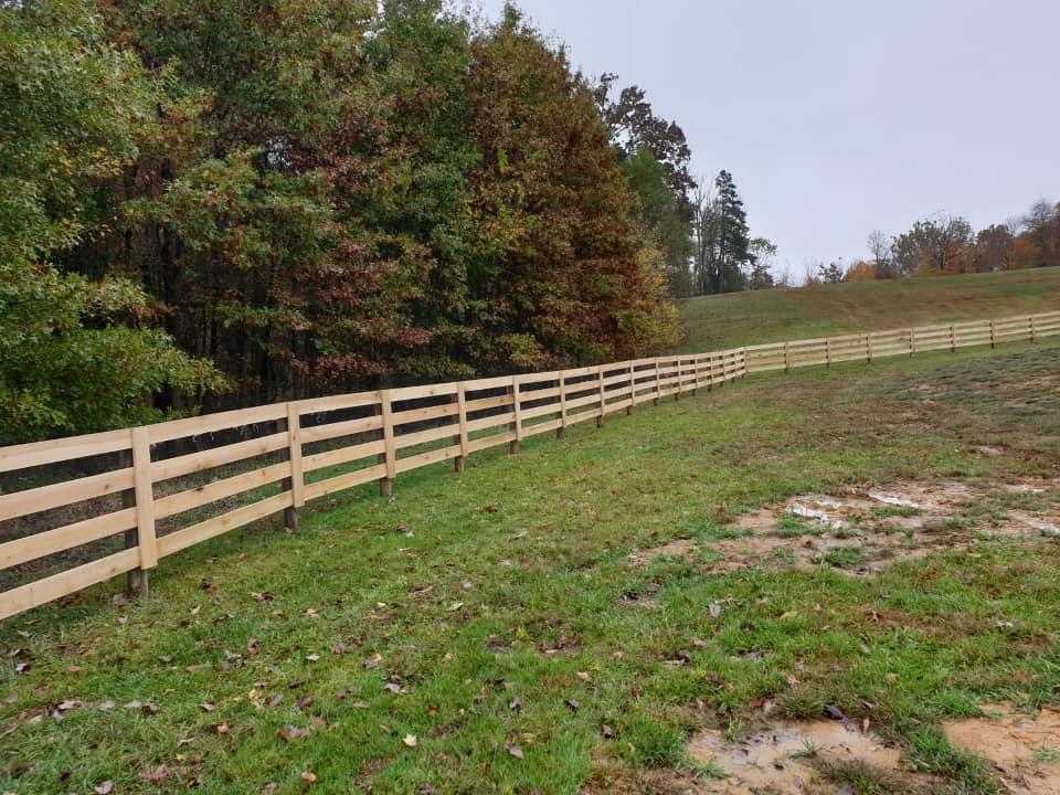 A board farm fence built by ARK Fencing