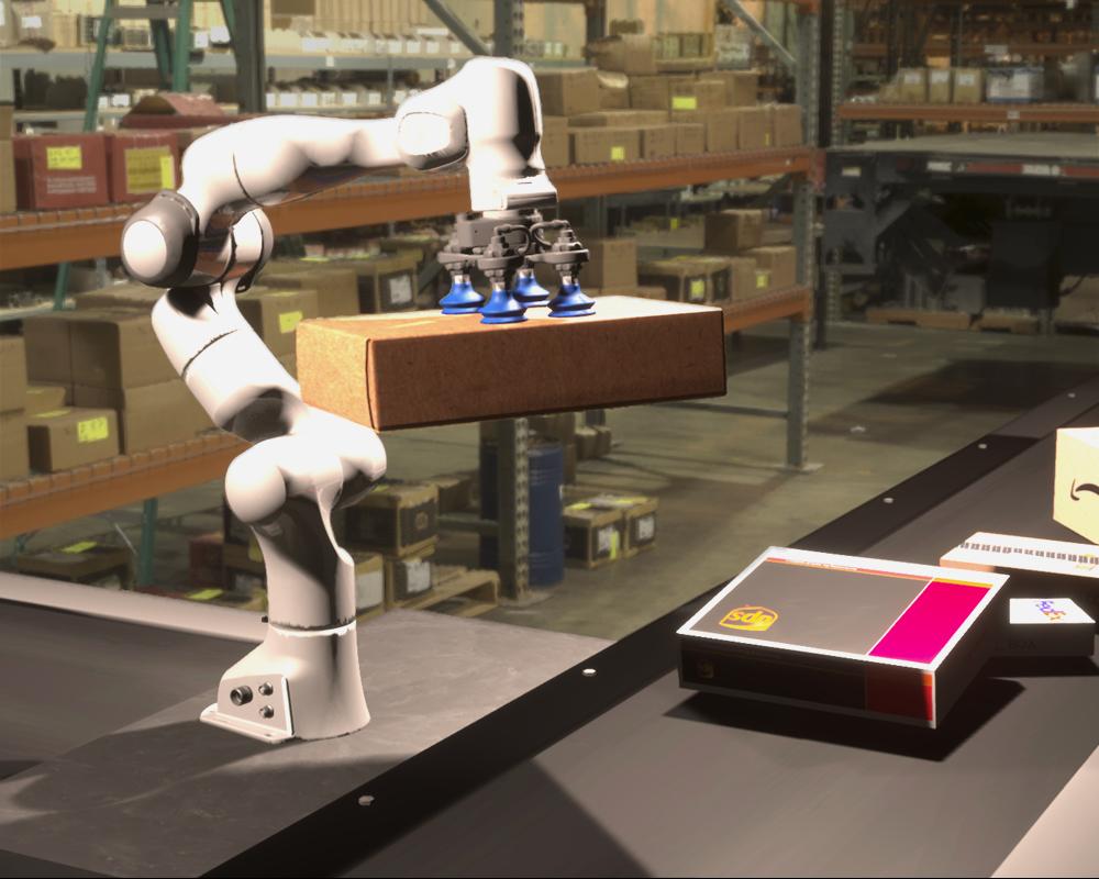 RGB image of a robot picking up a box